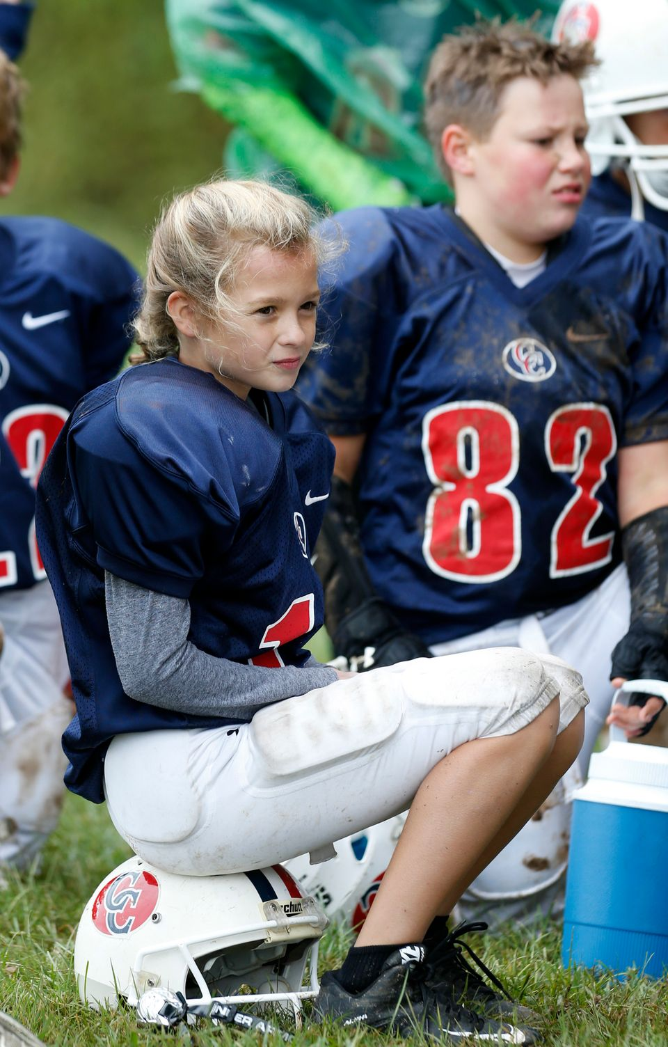 Juliette Haming listens as her position coach Clay Hunt gives a halftime talk.  Oct. 3, 2015