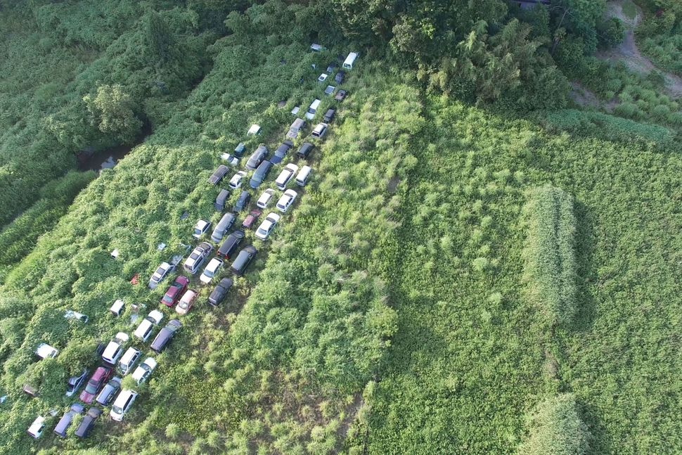 An aerial photo of cars that were abandoned.
