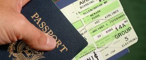 PASSPORT TICKET AIRLINE TRAVEL HAND CLOSE UP IMMIG