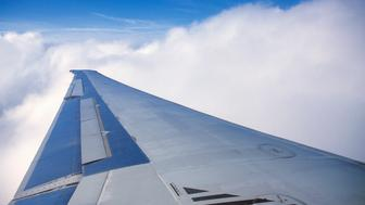 Airplane wing and clouds
