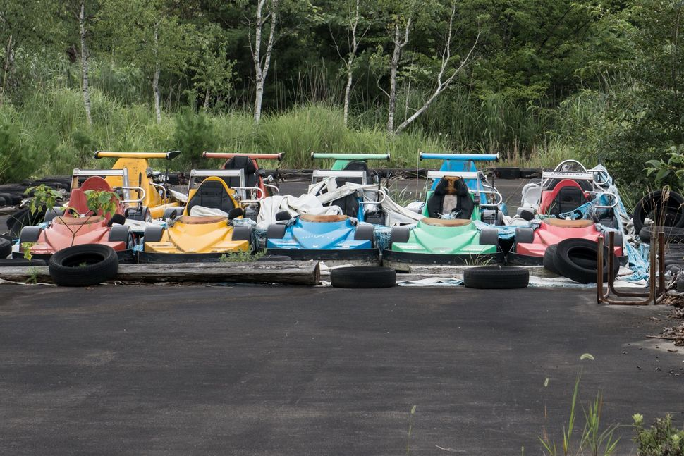Go karts lined up and ready to race.