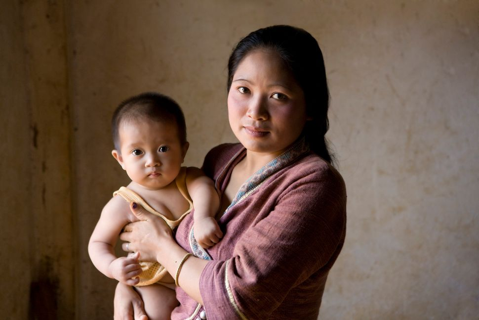 Image of a mother and child in Luang Prabang, Laos.