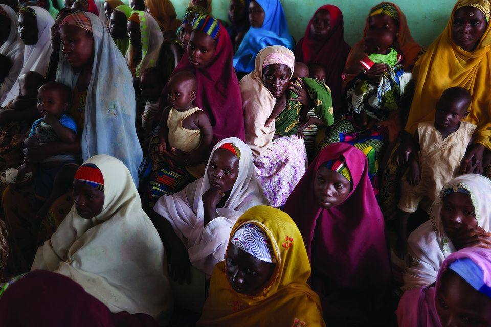 Women waiting to see healthcare workers in a village outside of Kano, Nigeria.
