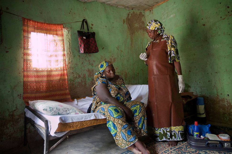 In Maiduguri in northern Nigeria, a traditional birth attendant counsels a mother about to give birth. There were approximate