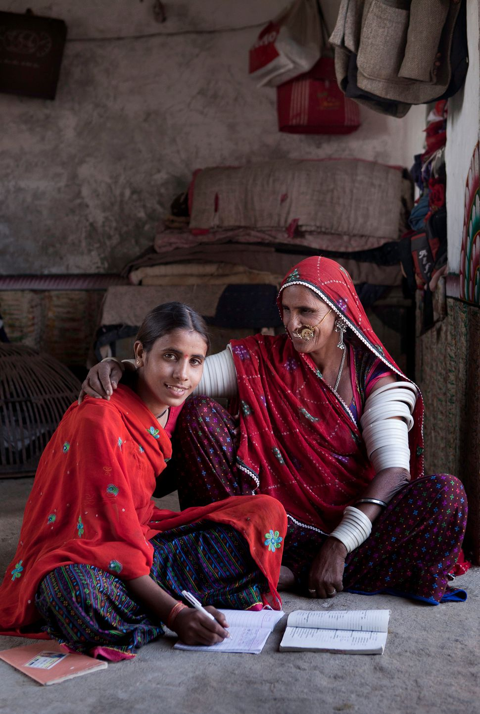 Nishi, a young woman from rural Rajasthan is pictured here with her mother, who supports and encourages her studies. The moth