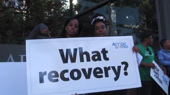 ACTION United activists outside the Federal Reserve Bank of Philadelphia on Tuesday, October 6, 2015