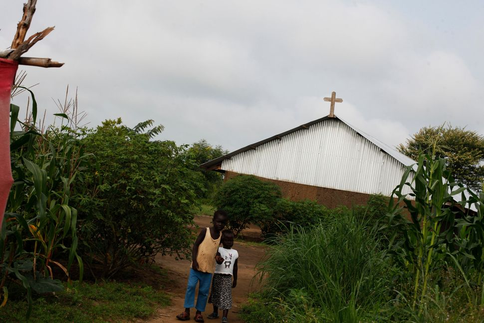 Anuak refugees, who fled Ethiopia, worship at a church in the Gorom Refugee Camp in South Sudan.