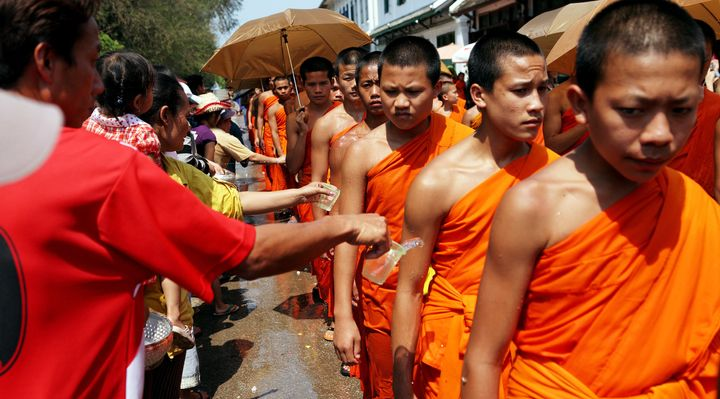 Devotees splash water on Buddhist monks during the Songkran festival in Luang Prabang, Laos, in April 2008. Homosexuality is