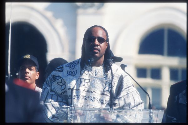 239824 06: Singer, songwriter & musician Stevie Wonder speaks to the crowd at the Million Man March October 16, 1995 in Washi
