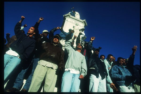 Attendees at the Million Man March raise their fists October 16, 1995 in Washington, DC. The purpose of the march was to galv