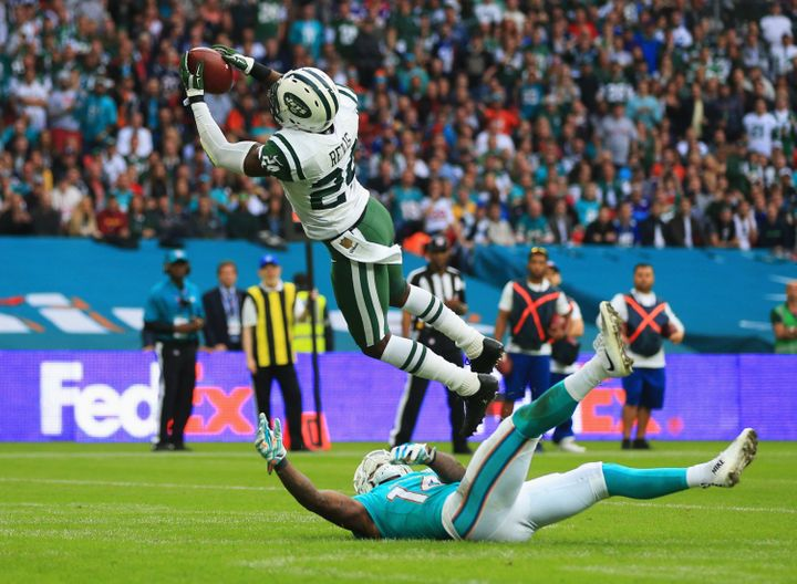 Darrelle Revis of the New York Jets intercepts a pass intended for Jarvis Landry of the Miami Dolphins on Oct. 4, 2015.