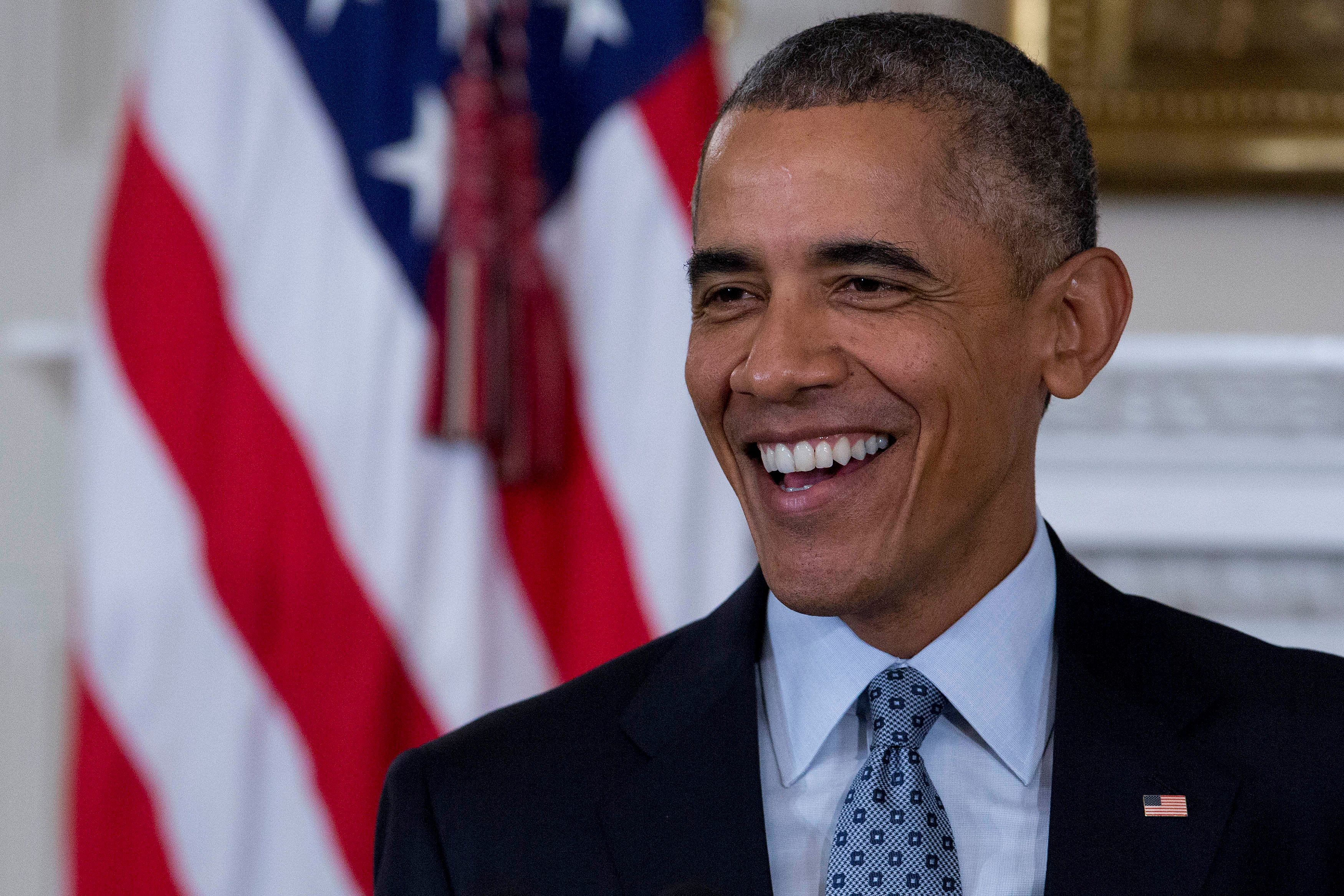 U.S. President Barack Obama, smiles during a news conference in the State Dining Room of the White House in Washington, D.C., U.S., on Friday, Oct. 2, 2015. Obama announced that Education Secretary Arne Duncan is stepping down in December and will be replaced by Deputy Secretary John B. King Jr. Photographer: Andrew Harrer/Bloomberg via Getty Images
