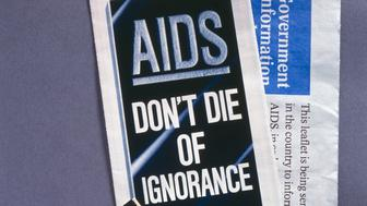 UNITED KINGDOM - DECEMBER 29:  Pamphlet titled 'AIDS: Don't Die of Ignorance', envelope marked 'Government Information about AIDS', and condom box by Keith Haring. The AIDS epidemic began in the 1970s and spread unchecked, so that by 1980, AIDS was present in North and South America, Europe, Africa and Australia. The disease can fatally affect the body�s immune system. People can catch human immuno deficiency virus (HIV), the virus that causes AIDS, in several ways, including through sexual contact. The condom is the only method of contraception that can protect against sexually transmitted diseases such as AIDS. In the late 1980s the British Government produced leaflets to raise public awareness of AIDS and promote safe sex.  (Photo by SSPL/Getty Images)