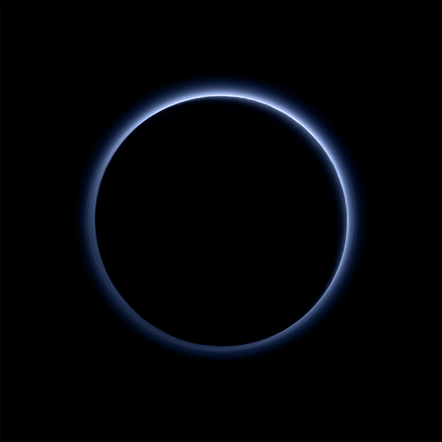 "<span class='image-component__caption' itemprop=""caption"">Pluto's haze layer looks blue in this picture taken by the New Horizons spacecraft. The high-altitude haze is thought to be similar to that seen at Saturn's moon Titan. The source of both hazes likely involves sunlight-initiated chemical reactions of nitrogen and methane, leading to soot-like particles (tholins) that grow as they settle toward the surface. This image was generated by software that combines information from blue, red and near-infrared images to replicate the color a human eye would perceive as closely as possible.</span>"