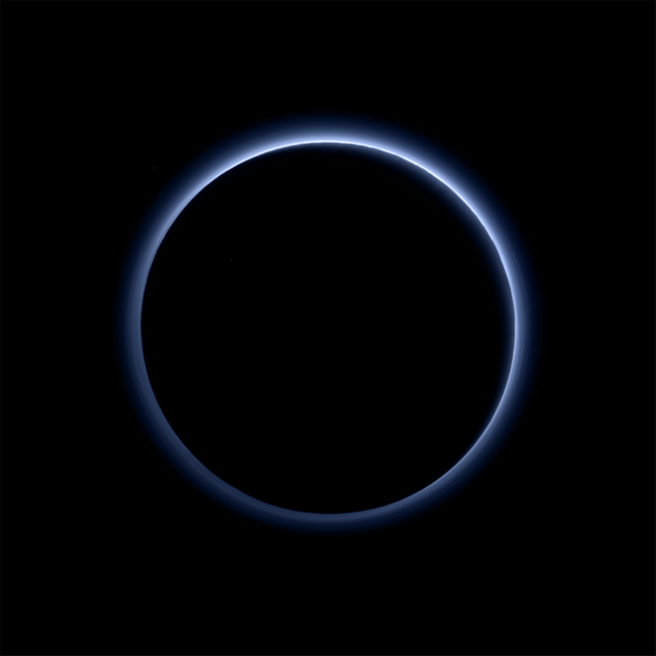 Pluto's haze layer looks blue in this picture taken by the New Horizons spacecraft. The high-altitude haze is thought to be s