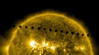 IN SPACE - JUNE 5-6:  In this handout composite image provided by NASA, the SDO satellite captures the path sequence of the transit of Venus across the face of the sun at on June 5-6, 2012 as seen from space. The last transit was in 2004 and the next pair of events will not happen again until the year 2117 and 2125. (Photo by SDO/NASA via Getty Images)