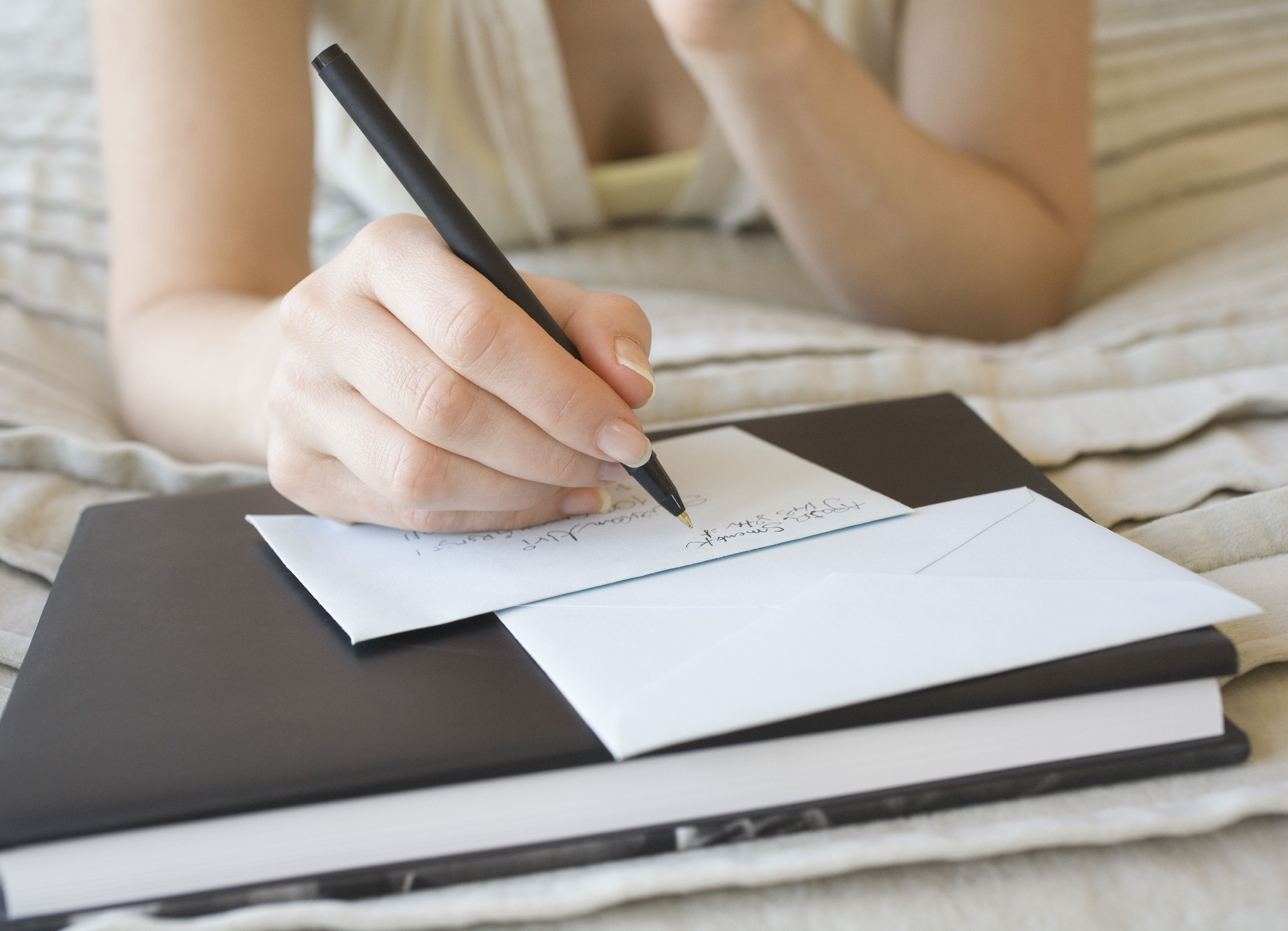 Woman writing on stationery