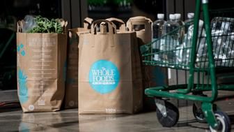 Bags of groceries sit at a Whole Foods Market Inc. store in Oakland, California, U.S., on Wednesday, May 6, 2015. Whole Foods Market Inc. released earnings figures following the close of U.S. financial markets today. Photographer: David Paul Morris/Bloomberg via Getty Images