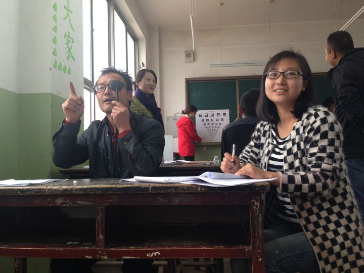Teachers in Wang Yao village practice administering eye exams.