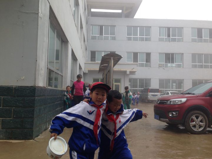 Students hurry to lunch at a school in Wang Yao Village.