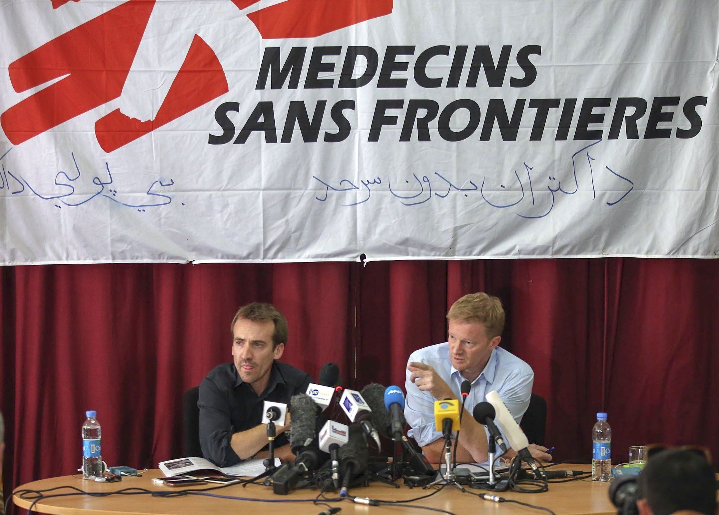 KABUL, AFGHANISTAN - OCTOBER 8: General Director of Doctors Without Borders, or Médecins Sans Frontières (MSF), Christopher Stokes (R)  and Country Representative, Guilhem Molinie (L) hold a press conference over the airstrike on Kunduz hospital, at the MSF office in Kabul on October 8, 2015. (Photo by Mustafa Bag/Anadolu Agency/Getty Images)