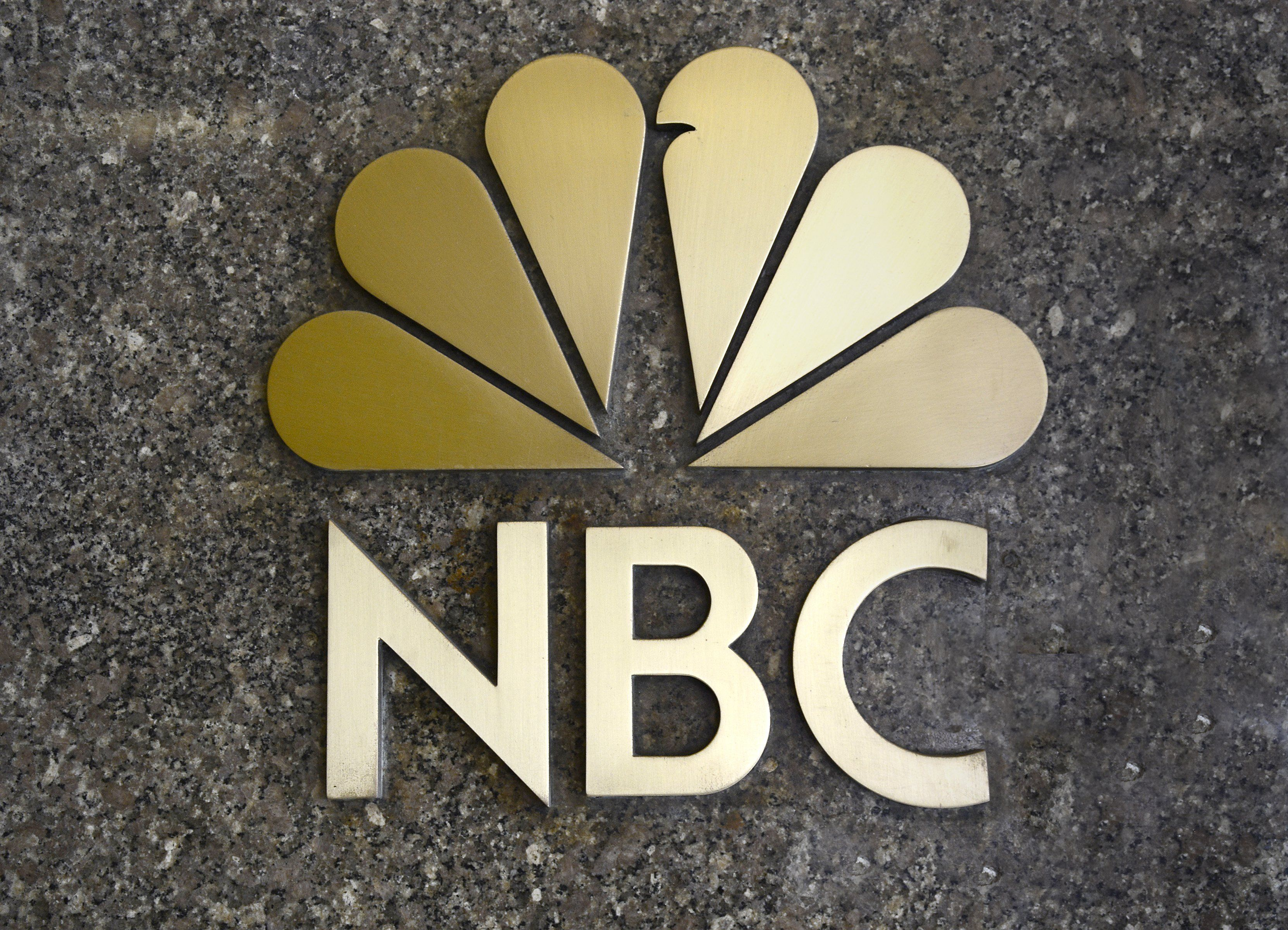 NEW YORK, NY - APRIL 26, 2015: The NBC television network 'peacock' logo' on a granite wall near the entrance to the network's headquarters in Rockefeller Center in Midtown Manhattan in New York, New York. (Photo by Robert Alexander/Getty Images)