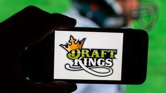 The DraftKings Inc. logo is arranged for a photograph on an Apple Inc. iPhone in Washington, D.C., U.S., on Sunday, Oct. 4, 2015. Fantasy sports companies DraftKings Inc. and FanDuel Inc. raised a total of $575 million in July from investors including KKR & Co., 21st Century Fox Inc. and Major League Baseball to attract players to games that pay out millions of dollars in cash prizes in daily contests. Photographer: Andrew Harrer/Bloomberg via Getty Images