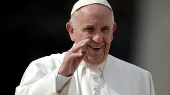 Pope Francis waves to the crowd at the end of his weekly general audience at St Peter's square on October 7, 2015 at the Vatican.  AFP PHOTO / FILIPPO MONTEFORTE        (Photo credit should read FILIPPO MONTEFORTE/AFP/Getty Images)
