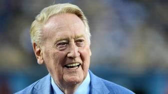 LOS ANGELES, CA - SEPTEMBER 23:  Los Angeles Dodgers broadcaster Vin Scully smiles on the field before the game against the Arizona Diamondbacks at Dodger Stadium on September 23, 2015 in Los Angeles, California.  (Photo by Harry How/Getty Images)