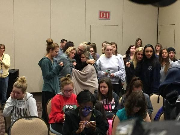 Students comfort each other at a press conference at Northern Arizona University following a shooting where 1 student was killed and 3 people were injured.