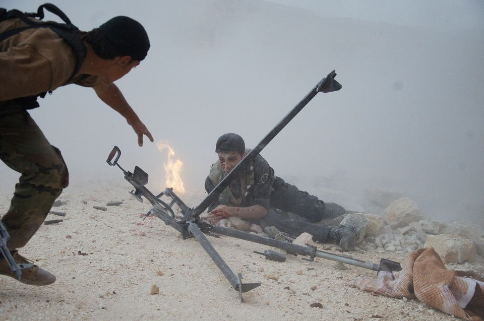 Members of Free Syrian Army clash against Syrian regime forces in Aleppo, Syria on Dec. 8, 2014.