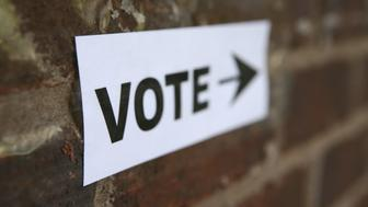 'Voter Sign with Arrow, shallow focus on the V in Vote.'