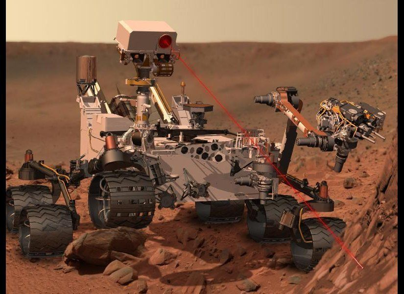 This artist's concept depicts the rover Curiosity, of NASA's Mars Science Laboratory mission, as it uses its Chemistry and Ca