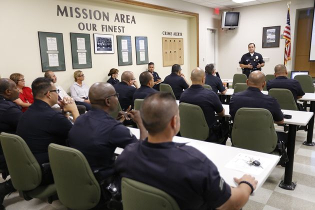 "<span class='image-component__caption' itemprop=""caption"">LAPD officers at a training session to learn how their department will use body cameras on Aug. 31, 2015.</span>"