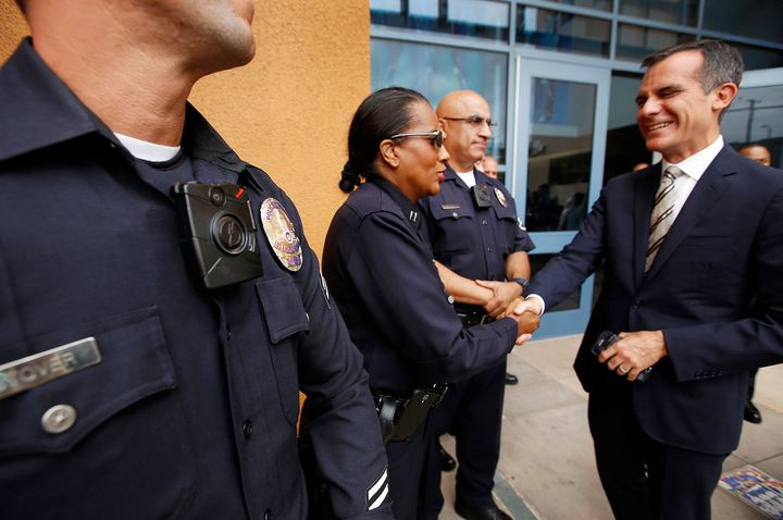 Los Angeles Mayor Eric Garcetti shakes hands with LAPD officers who are wearing the department's new body cameras on Sept. 4,