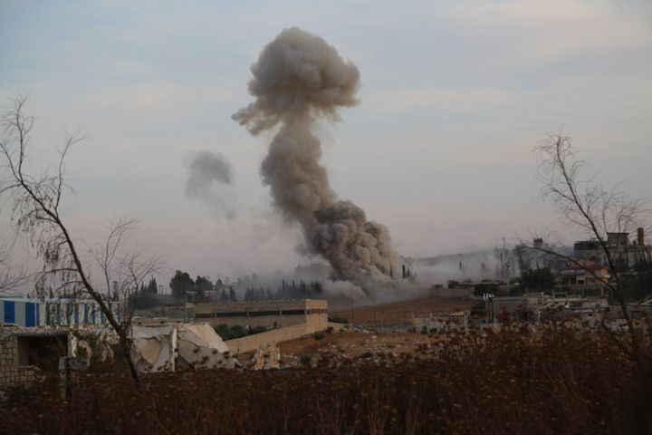 Smoke rises after Russian airtrikes hit ammunition-stores and bases of two opposition groups, in Mansoura region in the west