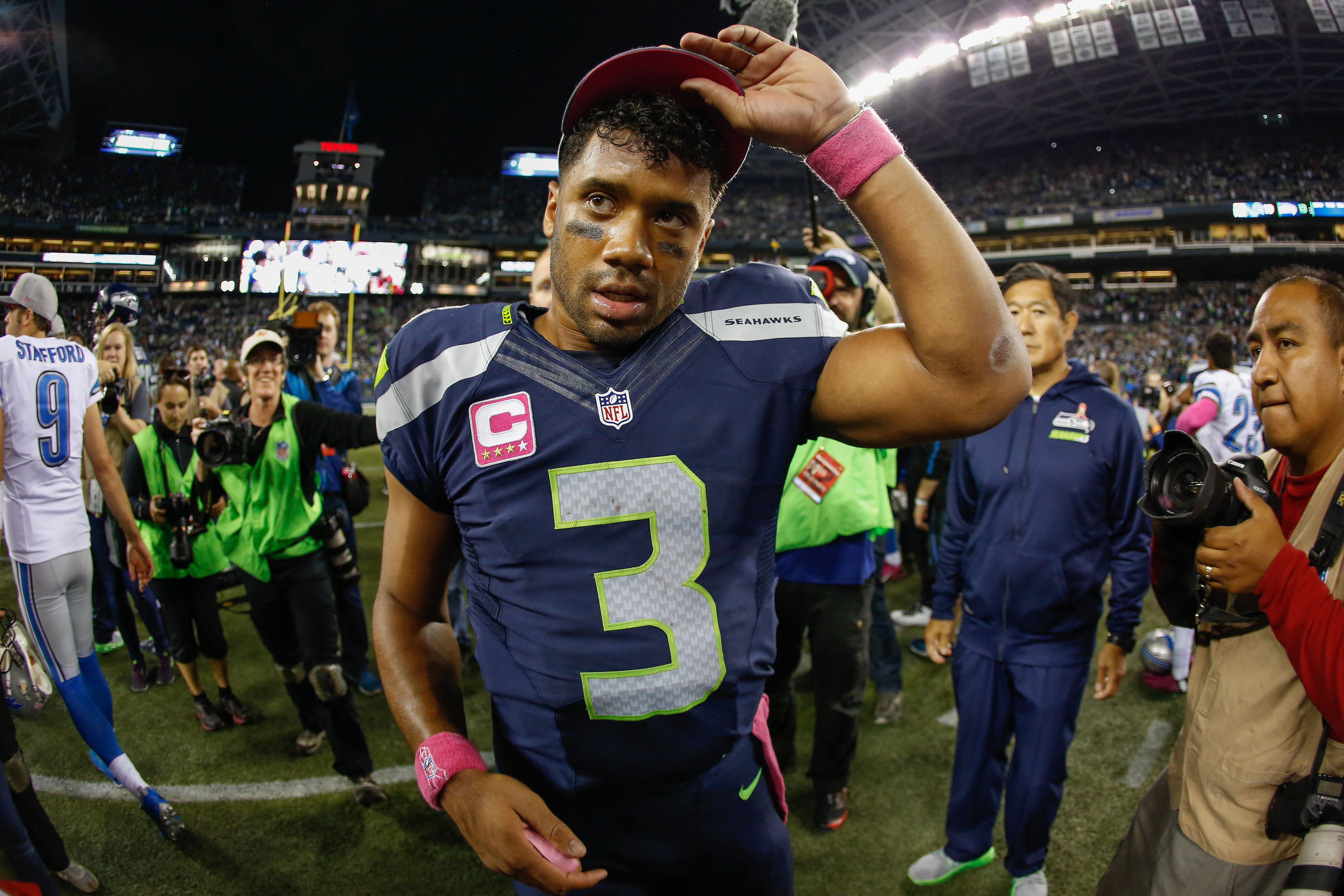 SEATTLE, WA - OCTOBER 05:  Quarterback Russell Wilson #3 of the Seattle Seahawks heads off the field after the game against the Detroit Lions at CenturyLink Field on October 5, 2015 in Seattle, Washington. The Seahawks defeated the Lions 13-10.  (Photo by Otto Greule Jr/Getty Images)