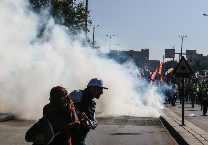 Turkish security forces use tear gas at the blast site in Ankara, Oct. 10, 2015.