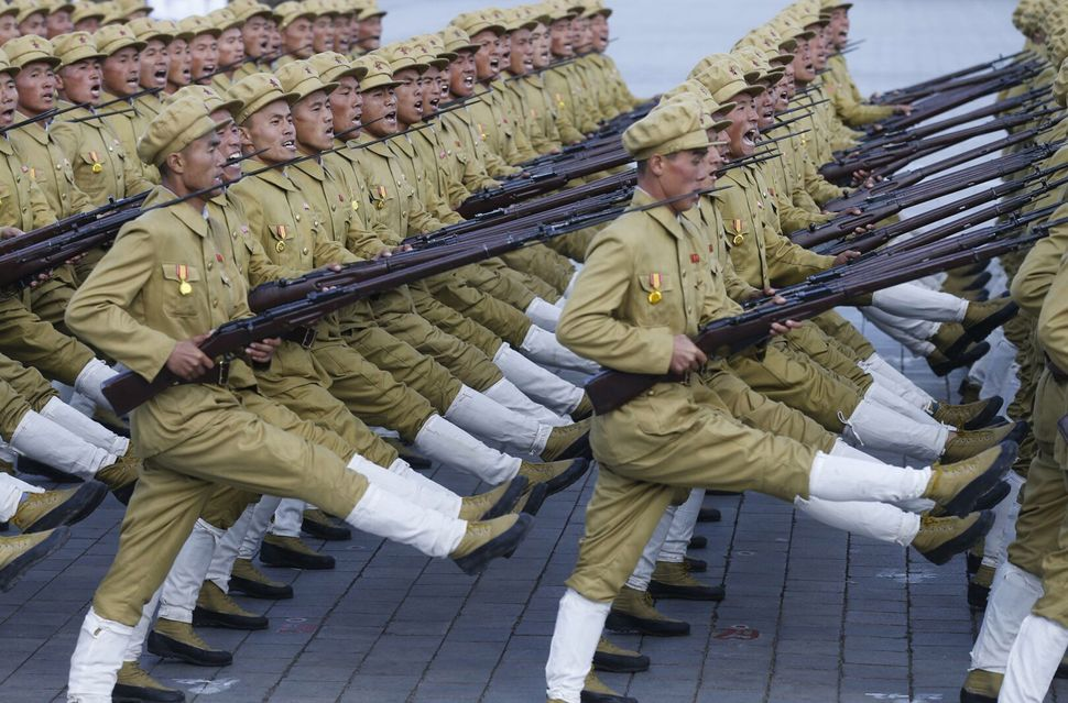 North Korean soldiers march in Kim Il-Sung Square, Saturday, Oct 10, 2015.