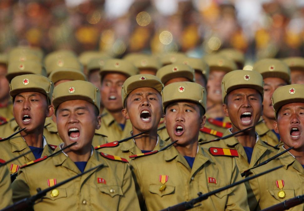 North Korean soldiers march in a military parade.