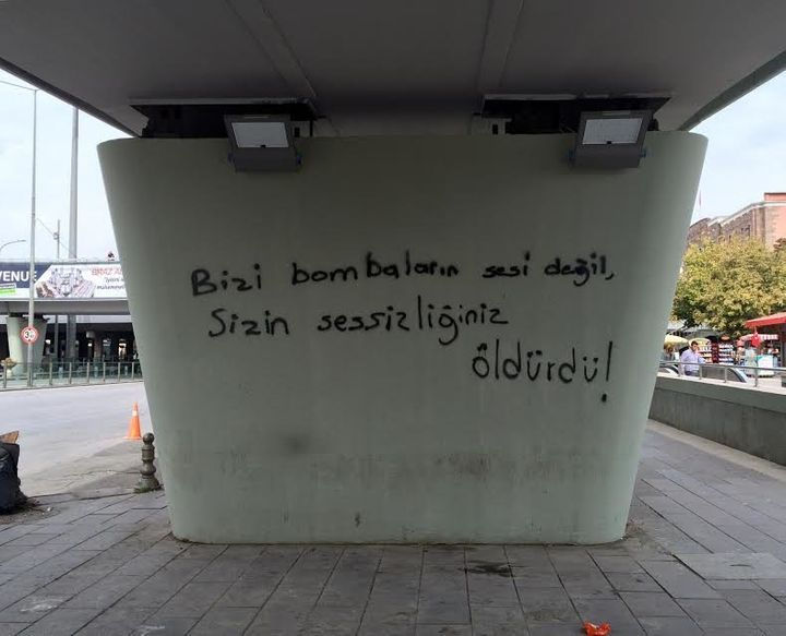"Graffiti on an Ankara bridge next to a mass anti-government rally reads: ""It was your silence that killed us, not the sound o"