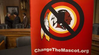 A poster for the 'Change the Mascot' campaign is seen prior to a press conference by the Oneida Indian Nation leaders on Capitol Hill in Washington, DC, September 16, 2014. 'Change the Mascot' is a national campaign to end the use of the racial slur Redskins as the mascot and name of the NFL team in Washington, DC. Launched by the Oneida Indian Nation, the campaign calls upon the NFL and Commissioner Roger Goodell to do the right thing and bring an end the use of the racial epithet.  AFP PHOTO / Saul LOEB        (Photo credit should read SAUL LOEB/AFP/Getty Images)