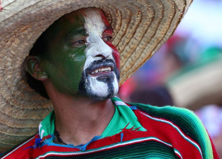 A Mexican fan wears his team's colors to show support during the 2017 FIFA Confederations Cup Qualifying match between Mexico