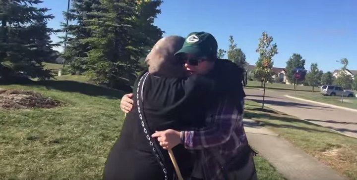 Cynthia DeBoutinkhar gives a protestor a hug outside an Islamic cultural center in Ohio.