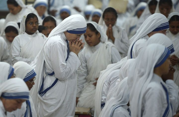 Nuns of the Missionaries of Charity pray at the tomb of Mother Teresa in the Mother House in Kolkata, India on September 15,