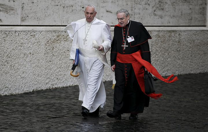 Pope Francis talks with Spanish cardinal Lluis Martinez Sistach as he arrives to lead the synod of the family at the Vatican,