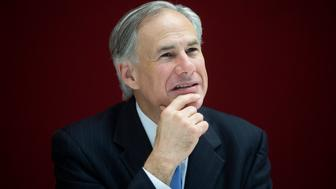 Greg Abbott, governor of Texas, pauses during an interview in New York, U.S., on Tuesday, July 14, 2015. Since Texas won a court case allowing it to refuse Confederate flag license plates, the state has been in the vanguard on the debate over whether states should remove flags, Abbott said. Photographer: Michael Nagle/Bloomberg via Getty Images