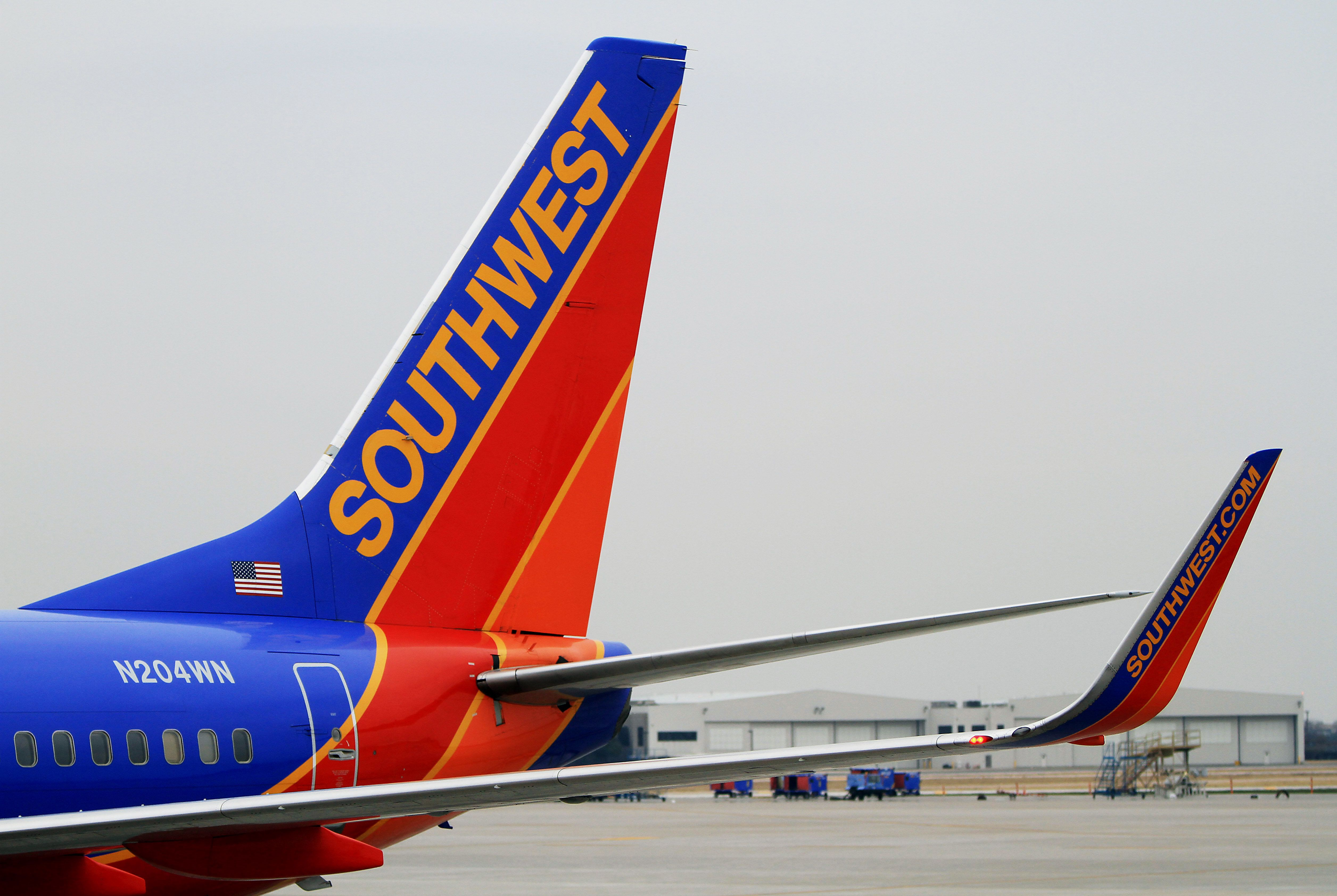 A Southwest Airlines Co. Boeing 737-7H4 plane sits at a gate at Dallas Love Field Airport in Dallas, Texas, U.S., on Monday, Feb. 3, 2014. Southwest Airlines Co., the largest domestic carrier, will begin flying to 15 new destinations from Dallas Love Field when flight restrictions at the airport closest to downtown end in October. Photographer Ben Torres/Bloomberg via Getty Images