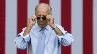 US Vice President Joe Biden takes his sunglasses off as he arrives for a campaign event with President Barack Obama at Strawbery Banke Field in Portsmouth, New Hampshire, on September 7, 2012.   AFP PHOTO / Saul LOEB        (Photo credit should read SAUL LOEB/AFP/GettyImages)
