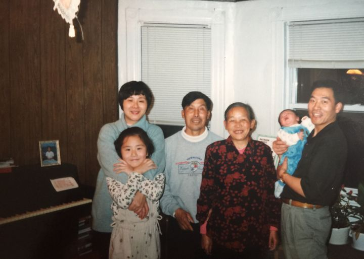 Li as a child with her parents, grandparents and younger brother, Jeffrey.
